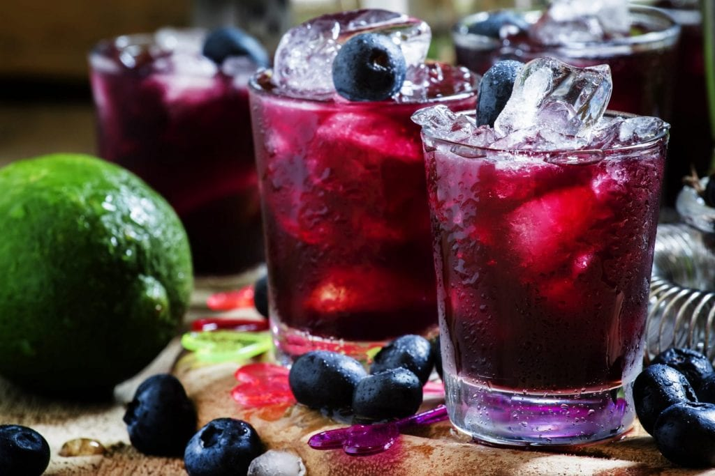 Old Glory Cocktail with blueberries and lime
